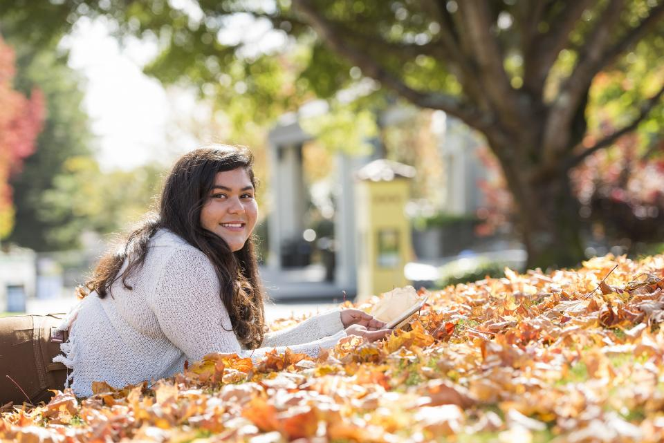 Student studying in the Fall